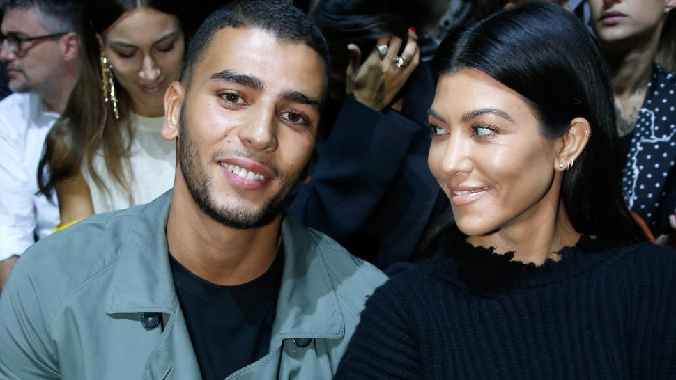 Kourtney Kardashian smiles at her boyfriend Younes Bendjima