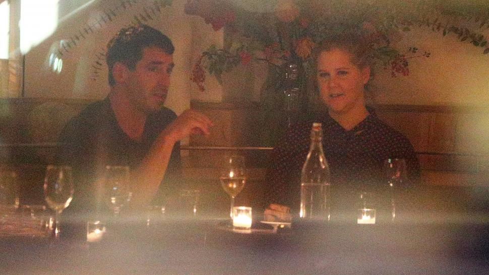 Amy Schumer and Chris Fisher captured together in a dinner in New York City