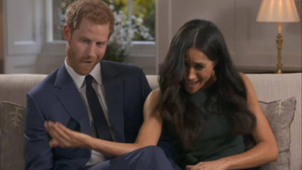 Prince Harry and Meghan Markle goof off during engagement interview.