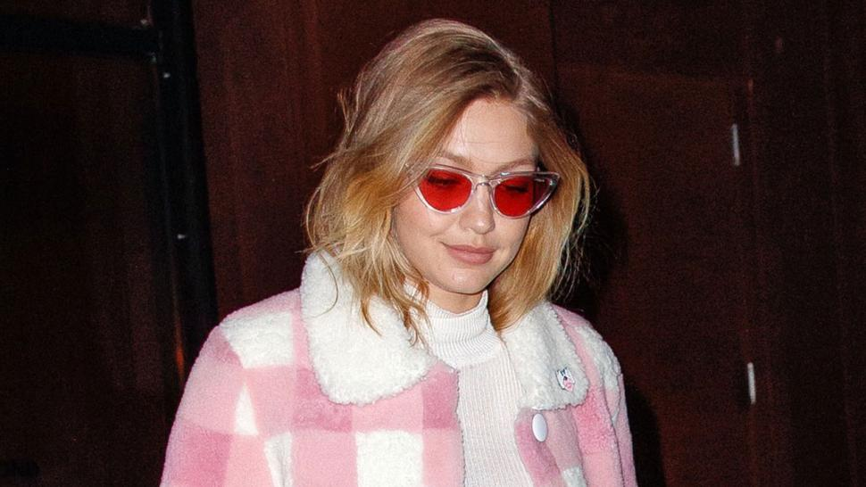 Gigi Hadid in NYC in pink plaid coat