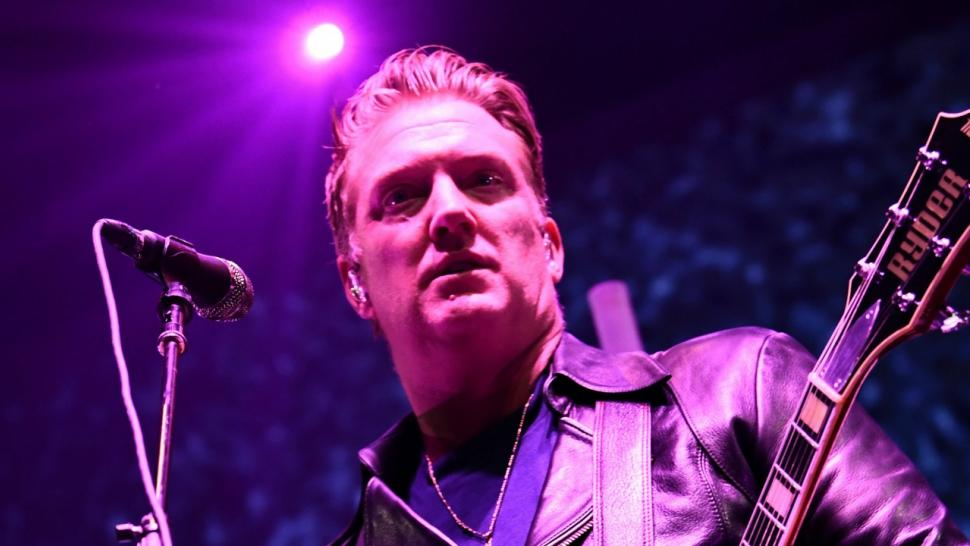 Queens of the Stone Age singer apologizes for kicking photographer during concert