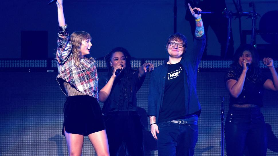 Taylor Swift performs with Ed Sheeran at Poptopia