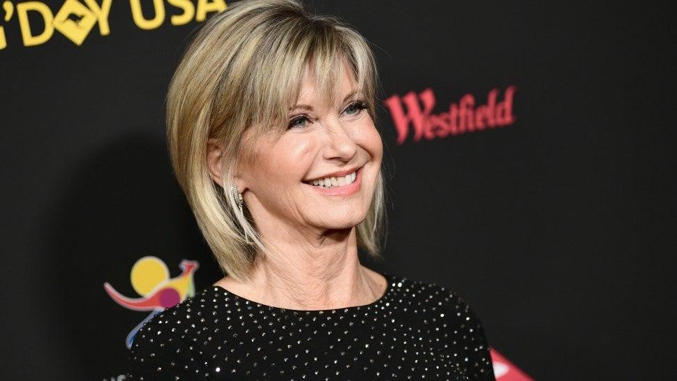 Olivia Newton-John's family denies singer is near death from cancer