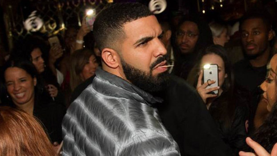 5c6f5e32e44 Drake at his Toronto restaurant. D USSE. Looks like things are getting  serious between Kourtney Kardashian ...