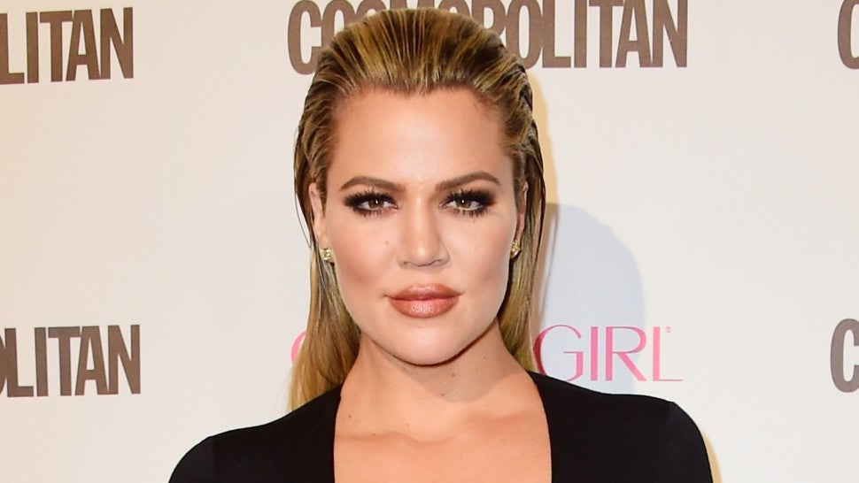 Pregnant Khloe Kardashian urged to DUMP boyfriend 'spotted kissing another woman'
