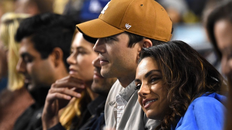 Ashton Kutcher and Mila Kunis attend the game between the Los Angeles Dodgers and the Oakland Athletics at Dodger Stadium on April 11, 2018 in Los Angeles, California.