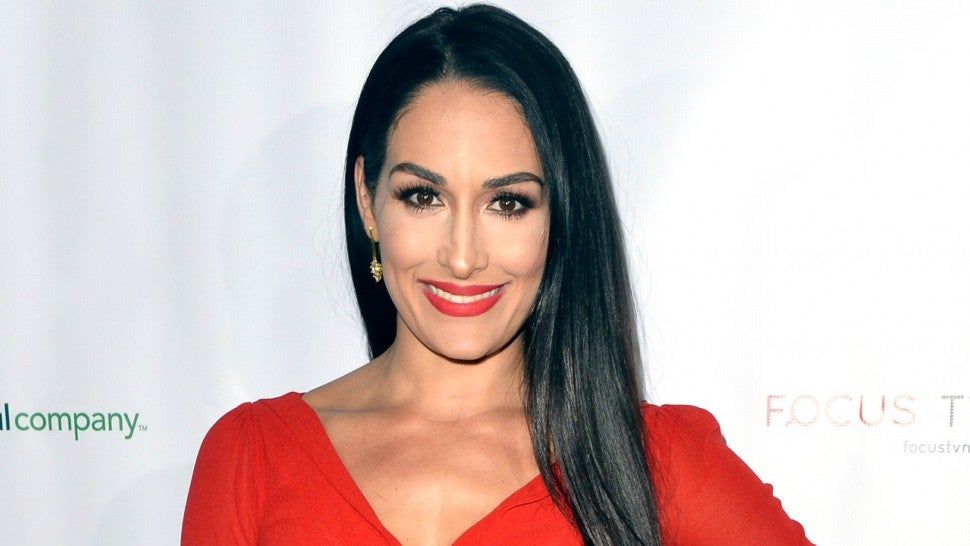 nikki bella gets a firsthand glimpse at motherhood when she looks