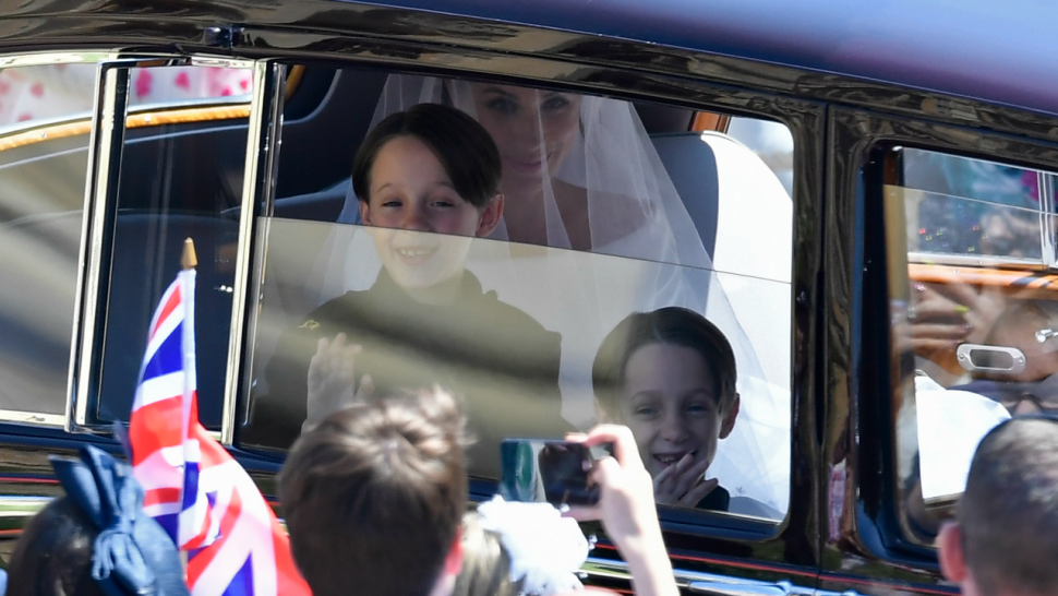 Meghan Markle is driven to St George's Chapel in Windsor Castle along with her page boys Brian and John Mulroney at St George's Chapel at Windsor Castle before the wedding of Prince Harry to Meghan Markle on May 19, 2018 in Windsor, England.
