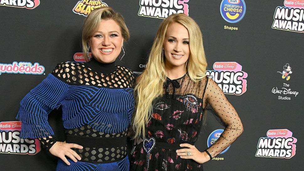 Kelly Clarkson, Carrie Underwood arrives at the 2018 Radio Disney Music Awards at Loews Hollywood Hotel on June 22, 2018 in Hollywood, California.