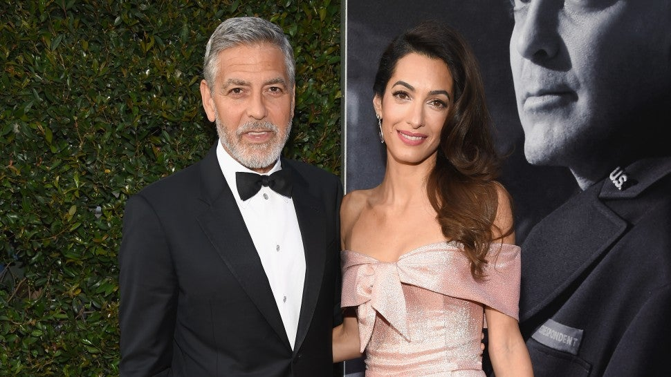 Amal helps George Clooney onto private jet after scooter crash