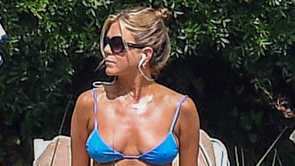 Jennifer Aniston Looks Super Fit in Blue Bikini While Lounging Poolside in Italy | Entertainment Tonight
