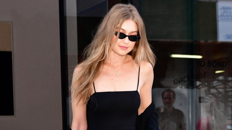 Gigi Hadid in black outfit and snakeskin belt