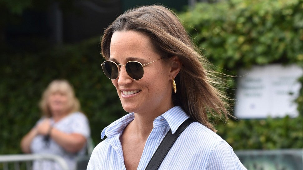 Pippa Middleton, pregnant, smiling, the sister of Kate shows her round belly
