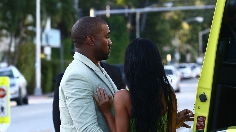 Kim Kardashian gets a helping hand from her man Kanye West while they grab ice cream.