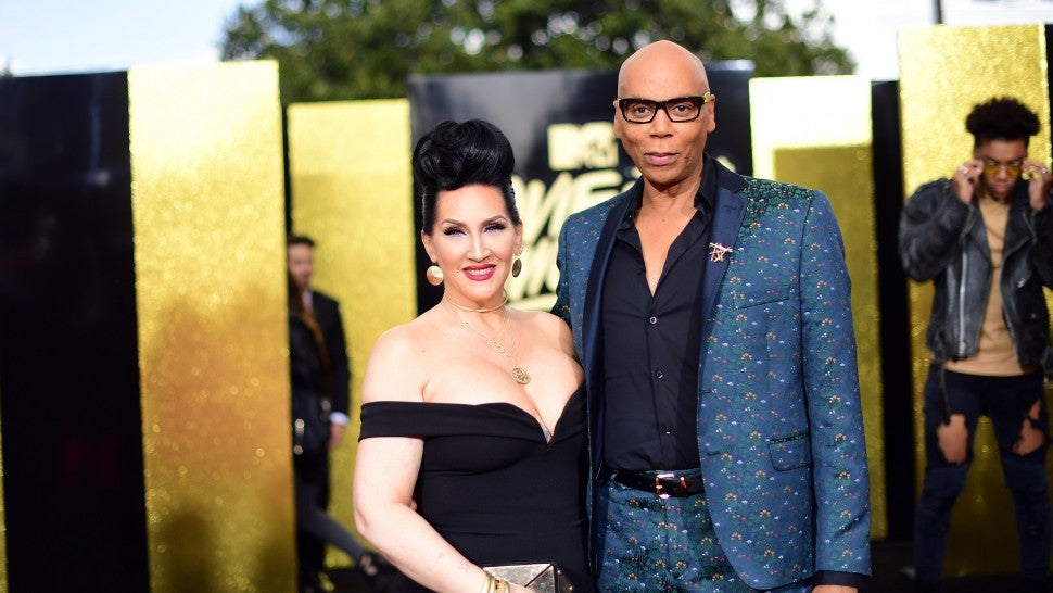 Michelle Visage and RuPaul pose on the red carpet.