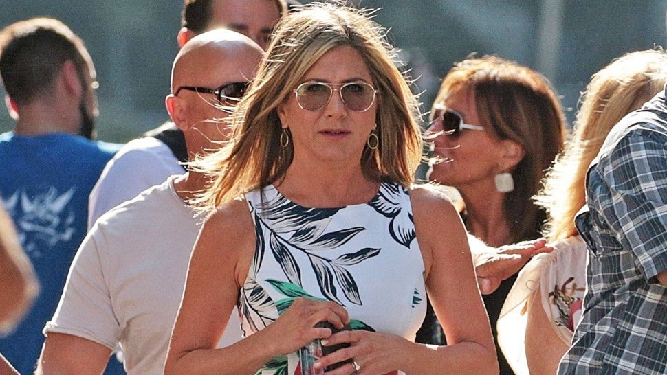 Jennifer Aniston in floral mini dress at Murder Mystery set