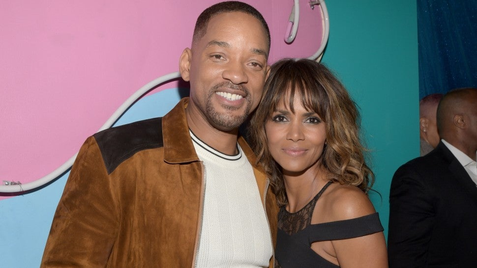 Will Smith and Halle Berry pose backstage at the 2016 MTV Movie Awards at Warner Bros. Studios on April 9, 2016 in Burbank, California.