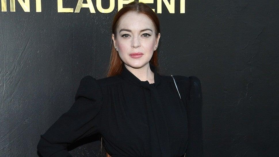 Lindsay Lohan Makes Rare Appearance at Paris Fashion Week