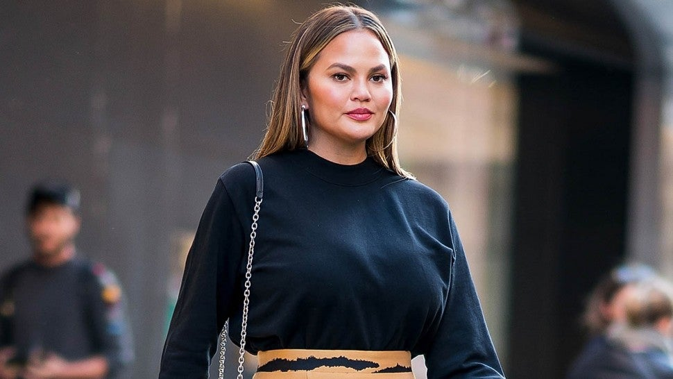 Chrissy Teigen Demonstrates How to Pull Off a Mini Skirt For Fall