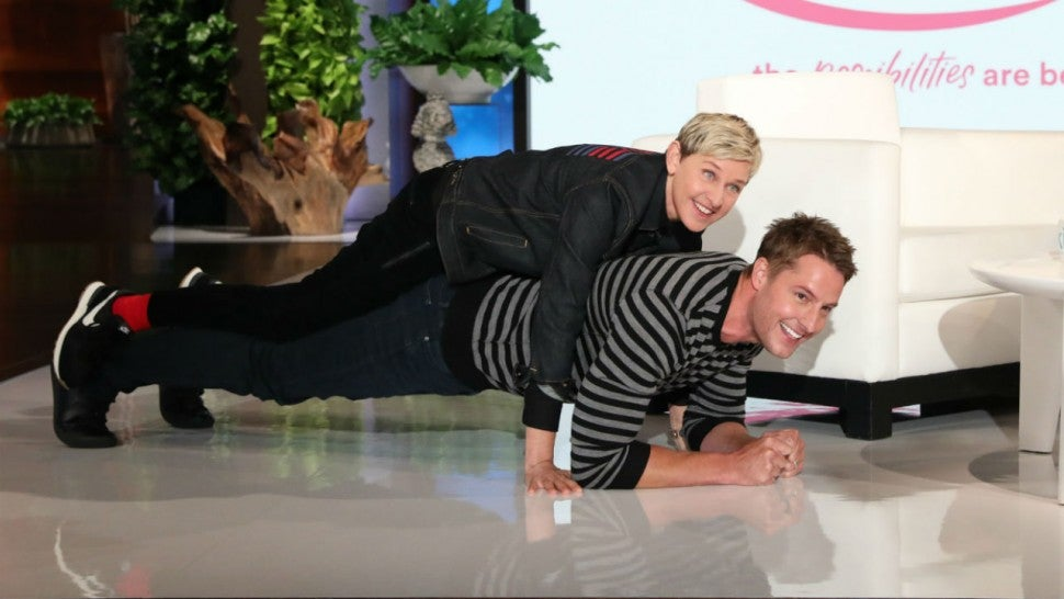 Justin Hartley Carries Ellen DeGeneres on His Back While Planking for Charity