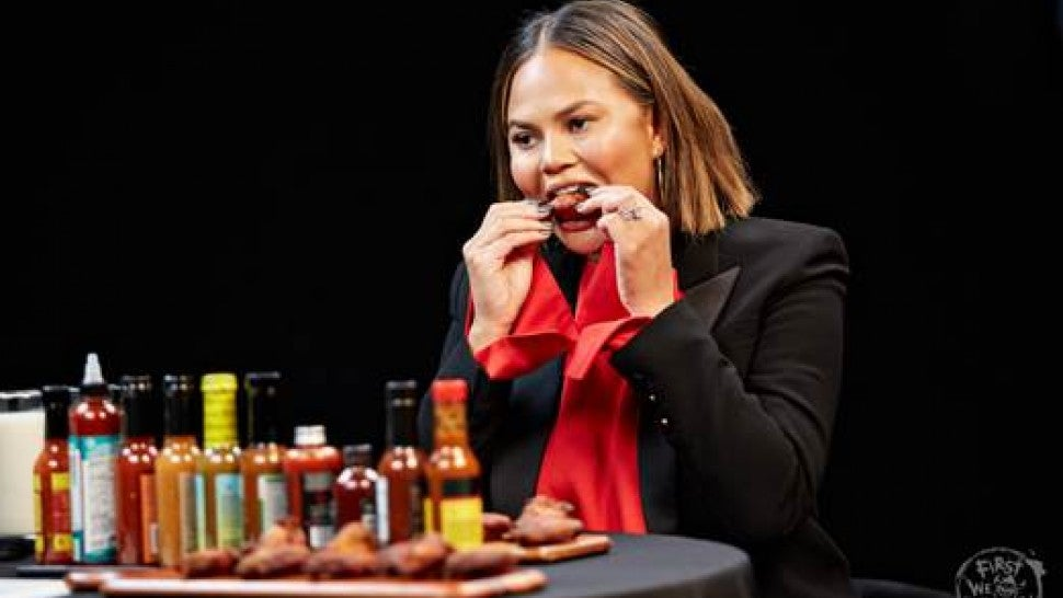 Chrissy Teigen Talks Threesomes and Twitter Wars While Downing Spicy Wings on 'Hot Ones'