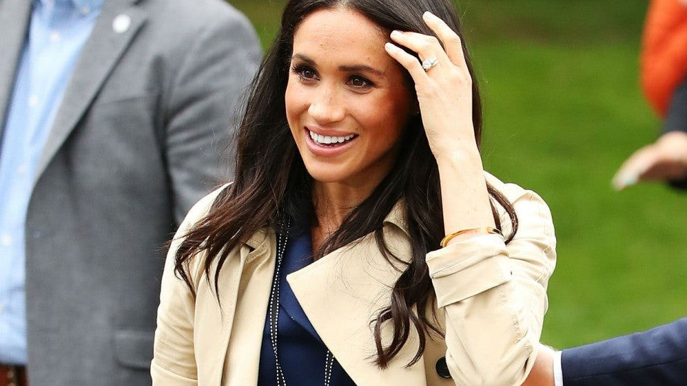 Glowing: Meghan's hint of a baby bump thrills royal fans