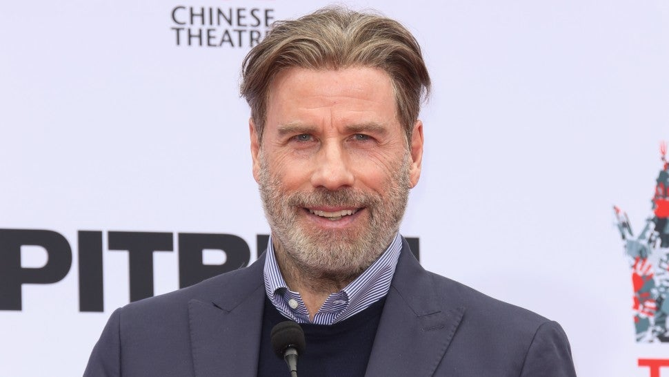 John Travolta finally ditches wig to reveal baldness