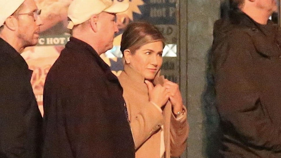 Actress Jennifer Aniston and director Mark Duplass film scenes for 'The Morning Show' on location in Los Angeles. Other cast members could also be seen roaming the set including Ian Gomez.