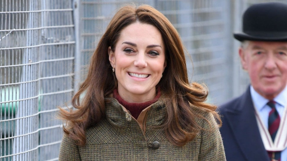 Kate Middleton wears purple on her visit to the royal opera house