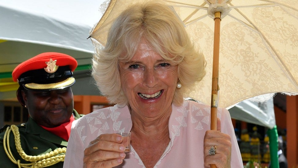 Camilla, Duchess of Cornwall, Enjoys a Shot of Rum During Royal Tour of the Caribbean