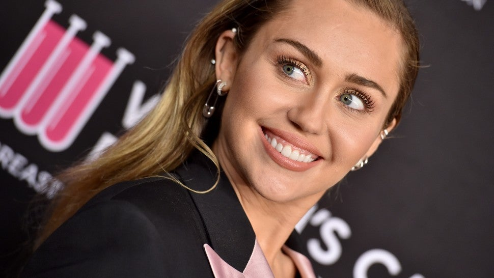Miley Cyrus Shares Nude Sunbathing Pic With Her Dog On National Puppy Day -5944