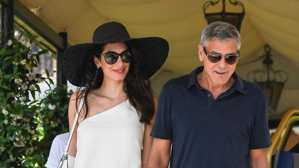 George Clooney and Amal Clooney are seen walking hand in hand as they leave their hotel to take an helicopter ride exploring Venice, Italy.