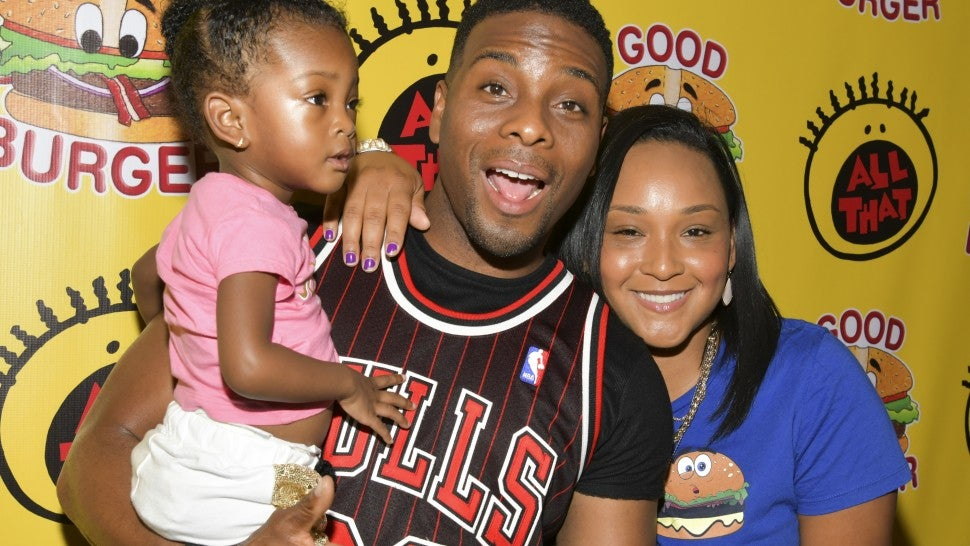 "Kel Mitchell with wife and daughter at Nickelodeon's ""Good Burger"" pop-up diner"