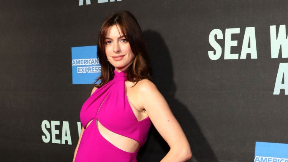 Anne Hathaway Glows Debuting Baby Bump In Sexy Hot Pink Cut-Out Dress
