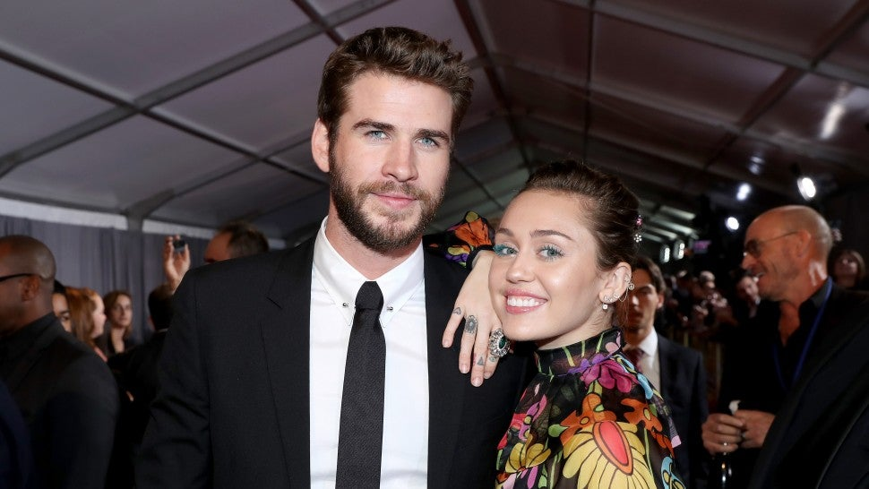 Liam Hemsworth and Miley Cyrus at Thor: Ragnarok in 2017