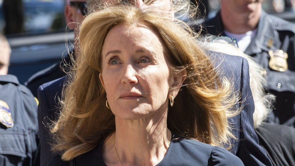 Felicity Huffman makes her way to the entrance of the John Joseph Moakley United States Courthouse September 13, 2019 in Boston, where she will be sentenced for her role in the College Admissions scandal.