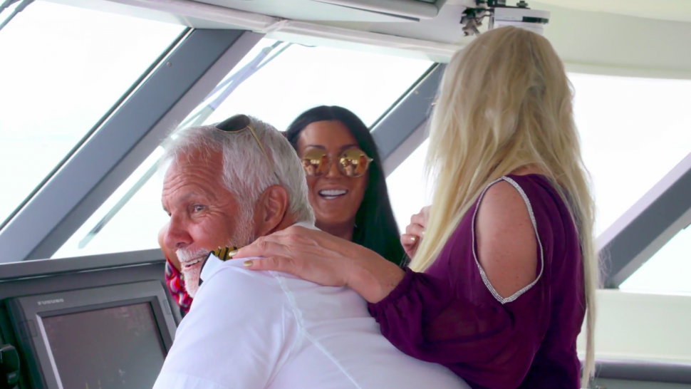 Captain Lee with the handsy charter guests on Bravo's 'Below Deck.'