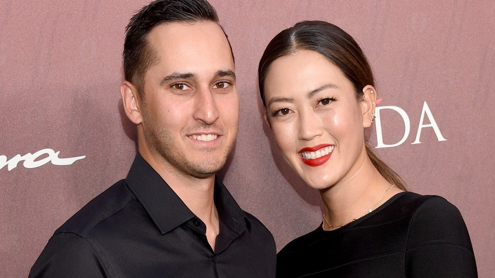 Michelle Wie and Jonnie West arrive at the Sports Illustrated Fashionable 50 at The Sunset Room on July 18, 2019 in Los Angeles, California.
