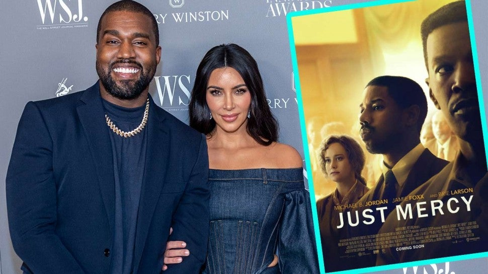 Kanye West and Kim Kardashian with 'Just Mercy' Poster