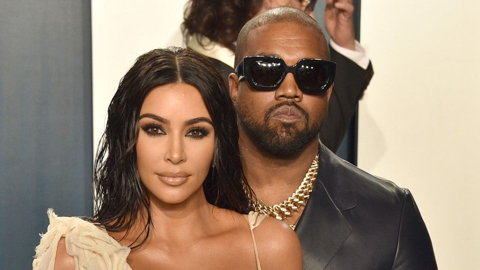 kim kardashian and kanye west at 2020 vf party