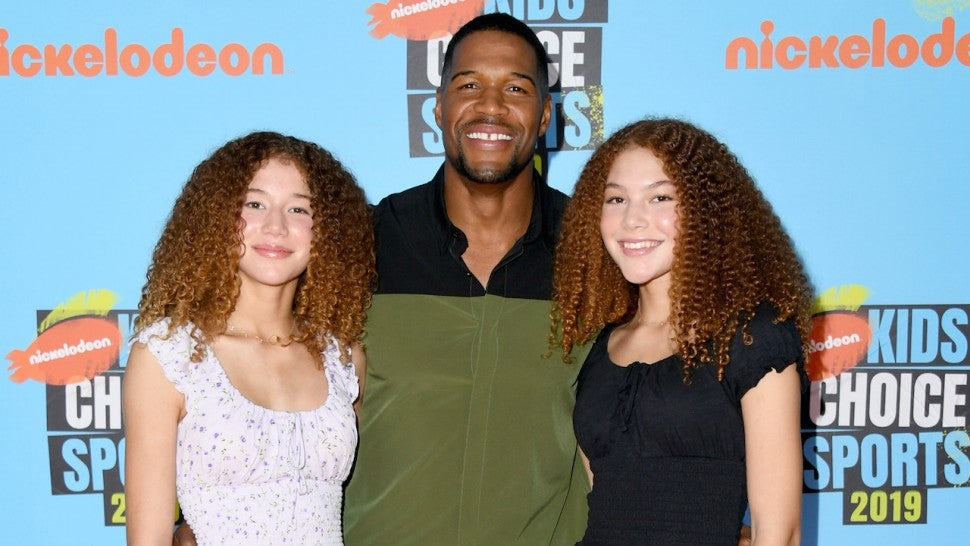 Michael Strahan with twin daughters