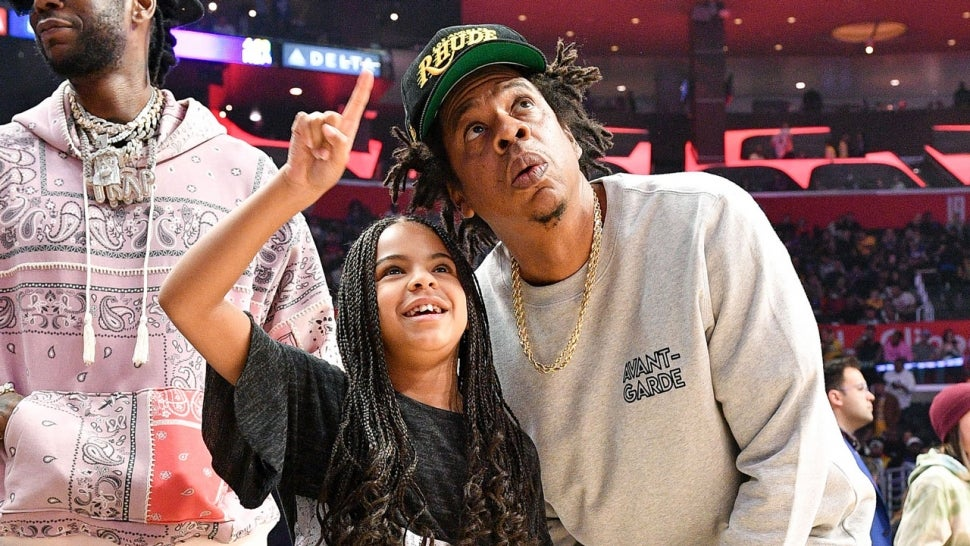 Jay-Z and Blue Ivy Carter attend a basketball game between the Los Angeles Clippers and the Los Angeles Lakers