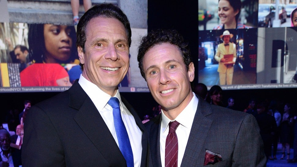 Andrew Cuomo and Chris Cuomo attend The Robin Hood Foundation's 2015 Benefit at Jacob Javitz Center on May 12, 2015 in New York City.