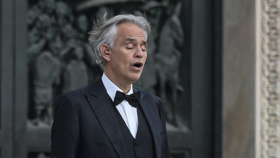 Italian tenor and opera singer Andrea Bocelli sings during a rehearsal on a deserted Piazza del Duomo in central Milan on April 12, 2020