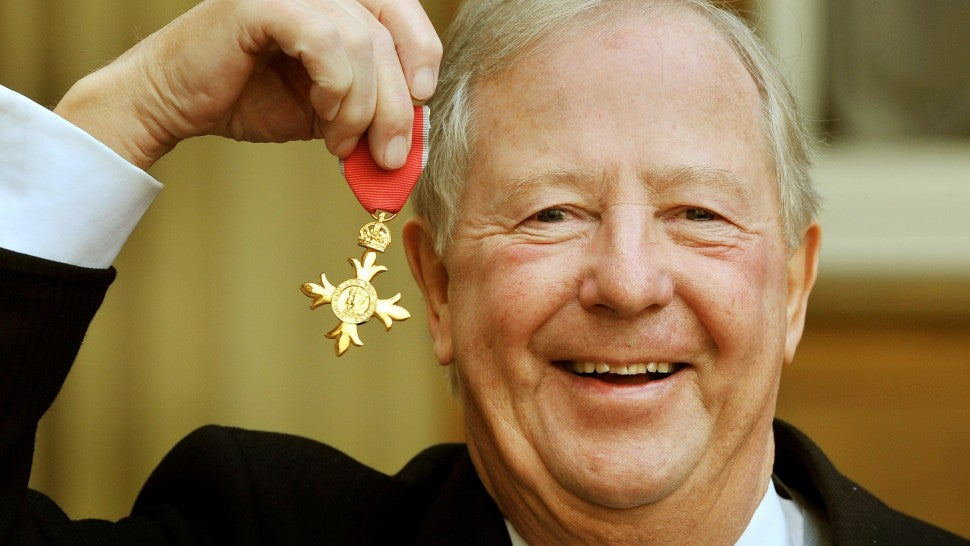 im Brooke-Taylor, proudly holds his OBE after it was presented to him by Prince Charles, Prince Of Wales