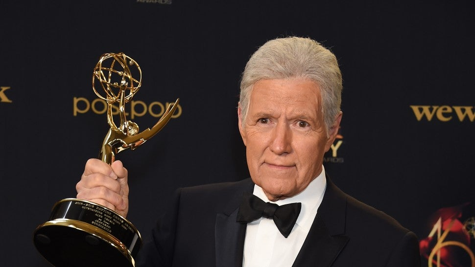 Alex Trebek poses with the Daytime Emmy Award for Outstanding Game Show Host in the press room during the 46th annual Daytime Emmy Awards