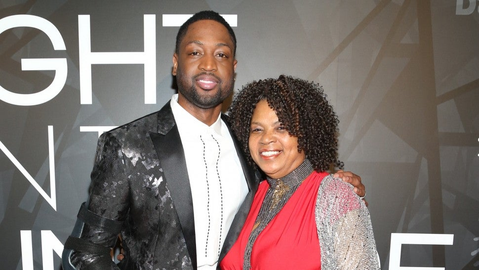 Dwyane Wade and his mom Jolinda Wade on the red carpet attending the Night on the Runwade Event at Revel Fulton Market on March 19th, 2017 in Chicago, Illinois.
