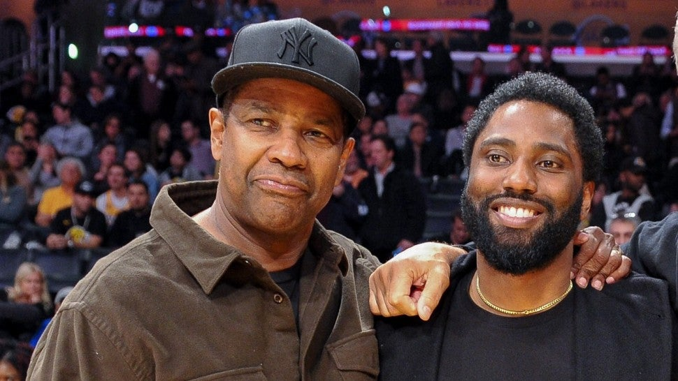 Actors Denzel Washington and son John David Washington attend a basketball game between the Los Angeles Lakers and the San Antonio Spurs at Staples Center on December 05, 2018 in Los Angeles, California.