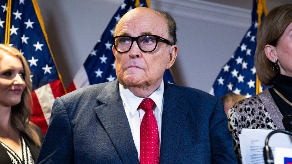Rudolph Giuliani, attorney for President Donald Trump, conducts a news conference at the Republican National Committee on lawsuits regarding the outcome of the 2020 presidential election on Thursday, November 19, 2020. Trump attorneys Jenna Ellis, left,and Sydney Powell, also appear.