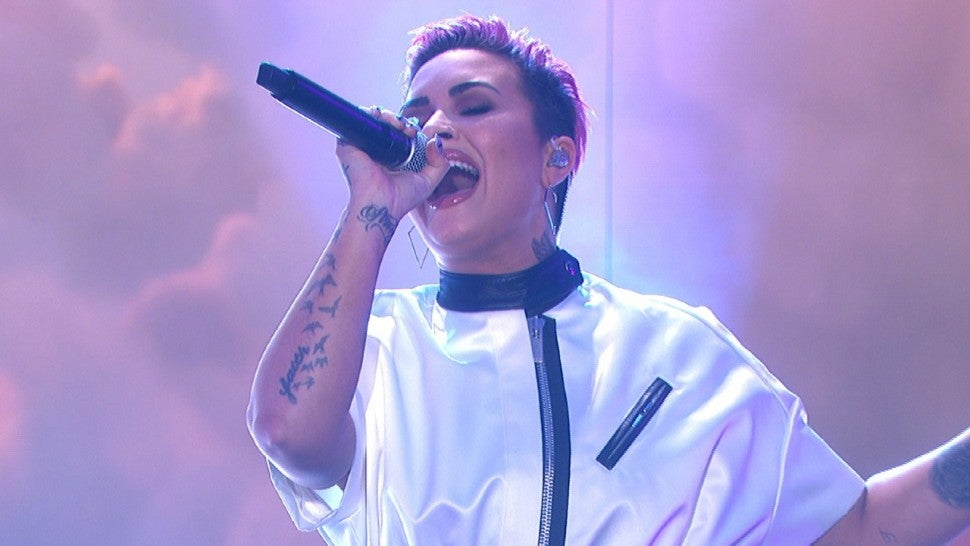Demi Lovato Says She Cut Her Hair Off After Using It to Cover Her Body.jpg